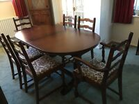 Solid oak dining room table and six Hallmark chairs