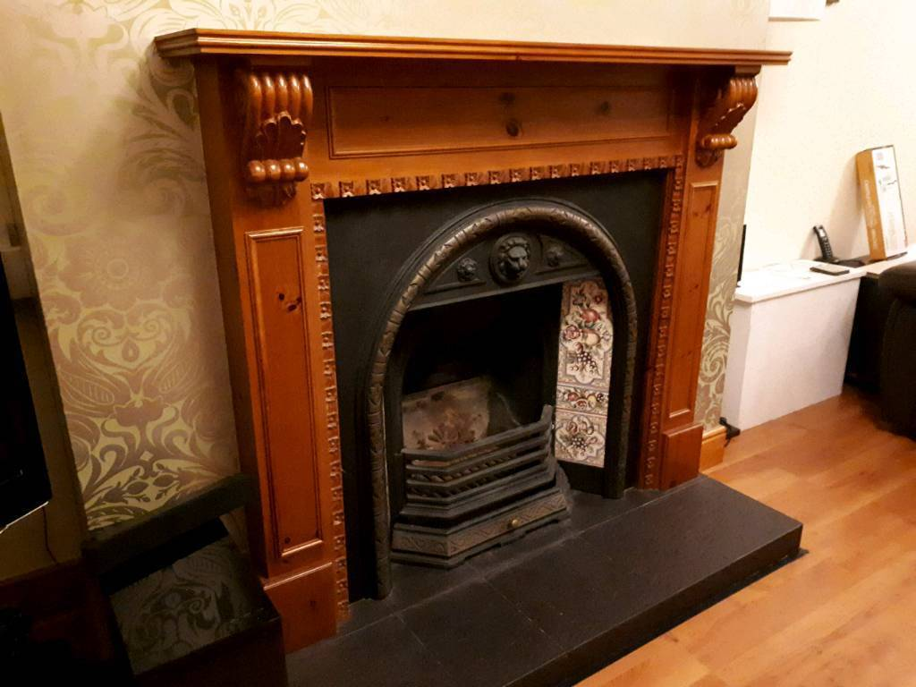 Fireplace with cast iron insert in very good condition