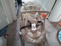 Baby bouncer in neutral colours excellent condition with carry handles