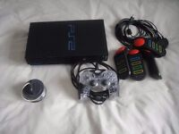 PS2 plus accessories 4 memory cards and 18 games