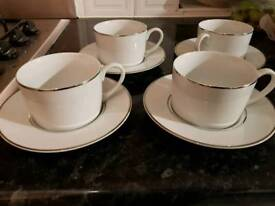 4 cup and saucers