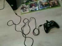 My xbox 360 black 2nd newest model with official controller and games