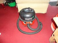 red and black henry hoover with pipe in good working order