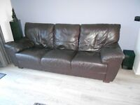 2 brown leather sofas with footstool