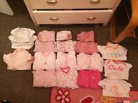 Large bundle of baby girls clothes ranging between 6-12 months