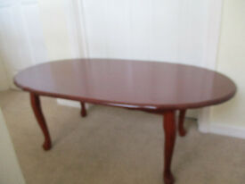 Mahogany colour oval coffee table.
