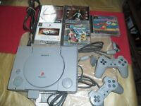 playstation 1 with 5 games & memory card