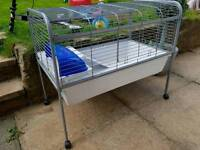 Indoor rabbit or guinea pig cage on wheels
