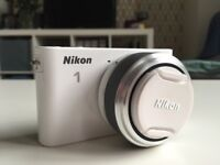 Nikon 1 J2 White Compact System Camera with 11-27.5mm Lens Kit, (10.1MP) 3 inch LCD and Accessories