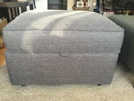 Grey fabric footstool with storage