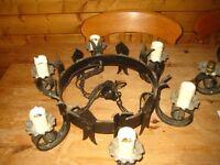 Two steel/wrought iron six light chandeliers