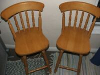 2 solid wood bar chairs, ideal for sitting at a breakfast bar or similar.