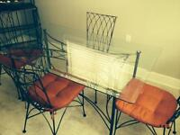 Glass and Iron table with four chairs