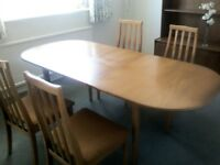 Teak Jentique Extending Table and four chairs