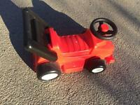 Red, plastic ride-on racing car (with horn)