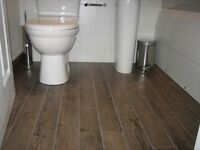 Amtico Rustic Smoked Wood - 20 Square Metres, cost £700