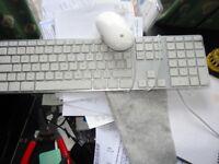 Genuine Apple wired USB keyboard with numeric keypad has 2 extra USB slots.