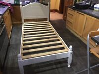 Child's single bed frame in white.