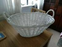 White wicker laundry basket