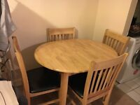 Oak extending dining table with 4 chairs