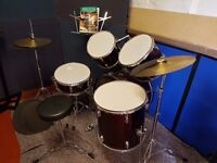 Drum Kit, 5 drums, 2 symbols, stool, music stand.
