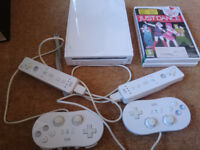 Nintendo Wii with controllers and games