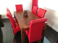 Solid rosewood dining table and 6 chairs