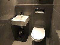 Complete bathroom suite- high end Porcelanosa brand. Toilet,wash hand basin,complete shower,radiator