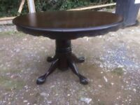 Solid oak extendable dining table and chairs finished in walnut