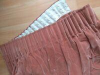 Large dusky pink velour curtains.