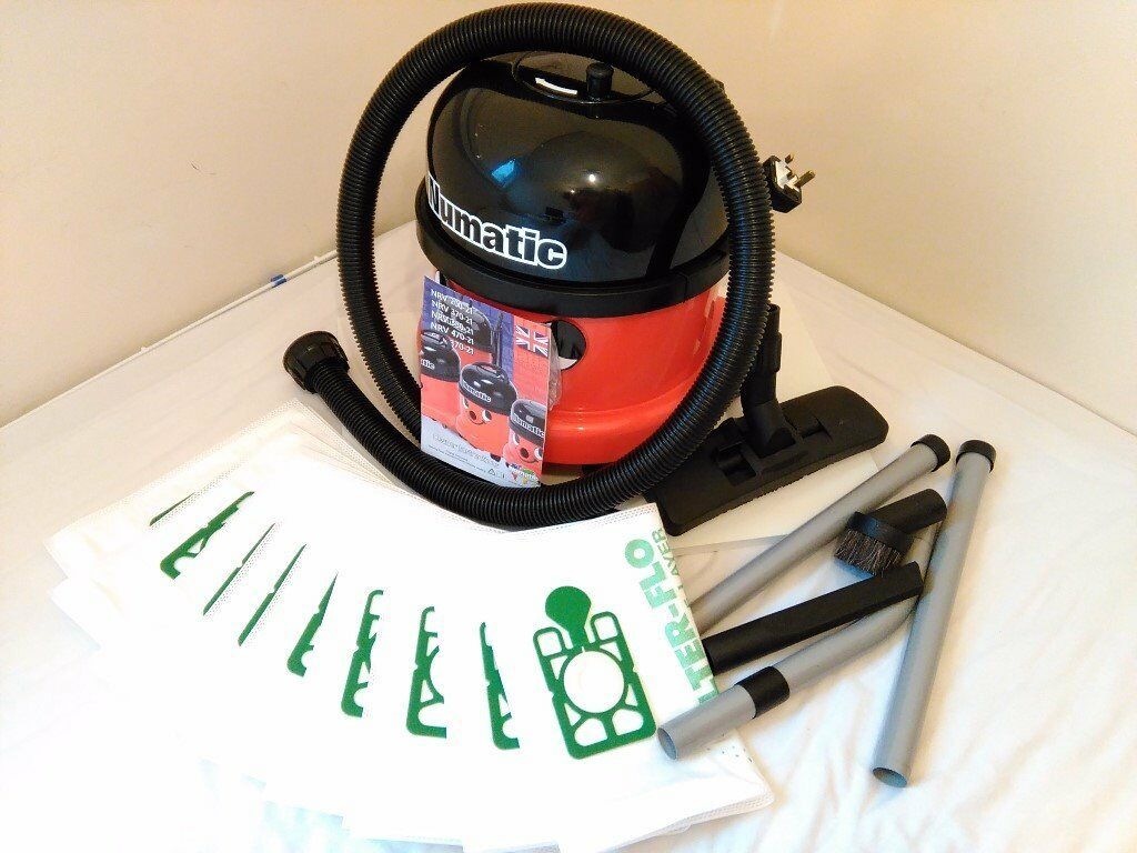 Henrry Vacuum Cleaner (Llike new, little use and with 10 bags; 1 in use and 9 new)