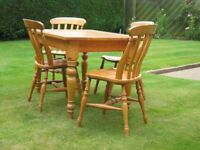 Kitchen table with Solid beechwood top and 4 chairs. Traditional design and in super condition.