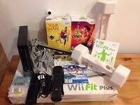 Black Nintendo Wii Console with Fit bundle, Balance Board, Tracking Camera and Motion Plus