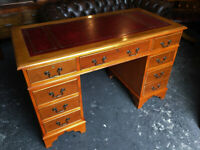 Oxblood leather pedestal desk...