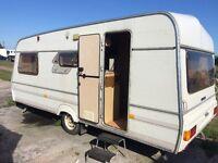 Hi I'm selling 4 birth caravan