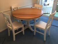 Solid oak round table with 4 chairs