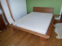Solid wood king size bed frame with clip-on side tables. No matress.