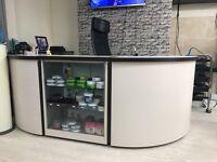 Reception desk, display cabinet, till