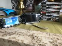 2 x Sony PSP with lots of games and charger