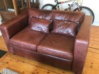 2 seat leather sofa. (2 sofas matching available)