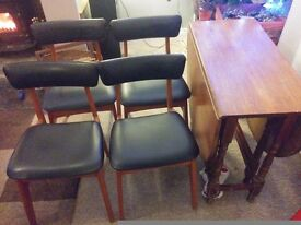 A folding Table & 4 Schreiber black vinyl covered dining chairs