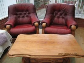 TWO LEATHER CHAIRS, COFFEE TABLE AND POUFFEE