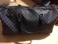 Designer leather weekend bag unisex