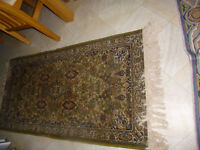 small green/red rug