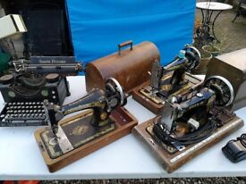 Antique sewing machines and typewriter