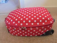 RED & WHITE SPOTTED SUITCASE/CABIN BAG. EXCELLENT CONDITION.