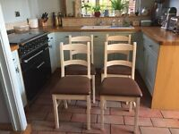 White wooden dining chairs