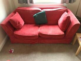 2 x red 2 seater sofas