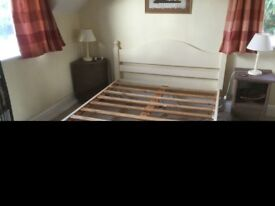Slatted double bed, wardrobe and chest of drawers