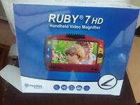 Optilec Ruby 7HD handheld video magnifier to aid those with extremely poor vision.
